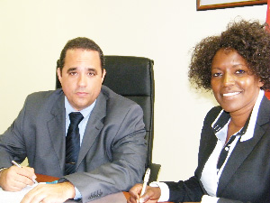 (Left to right) Emilio Rodriquez and Hilma Hitula, director of Namibia Housing Initiative (Photograph by Johanna Absalom)