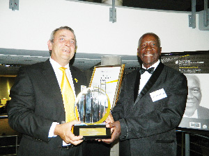 Gerhard Fourie, managing partner of Ernst & Young and Frans Indongo, pose with the Lifetime Achievement Award. (Photograph by Lorato Khobetsi)