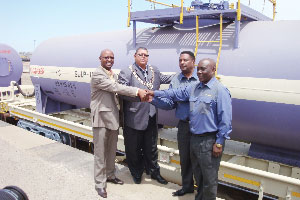 Mpho Mothoa, Rössing's chief operating officer, Derek Klazen, mayor of Walvis Bay; Hans Karon, chief: Delivery Service, Western Region, TransNamib and Charles Funda, chief operations officer at TransNamib, at the hand over of the acid tankers. (Photograph contributed)