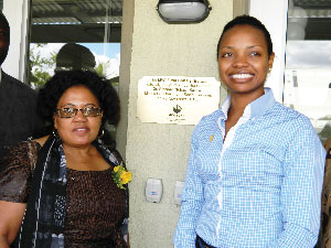 Deputy Minister of Health and Social Service, Petrina Haingura inaugurated the MVA Fund Call Centre on behalf of Dr Richard Kamwi, the Minister of Health and Social Services at the fund's head office on Tuesday. Haingura and Rosalia Martin-Hausiku, acting CEO of the MVA Fund, poses for the Economist cameras in front of the MVA Fund Call Centre. (Photograph by Lorato Khobetsi)