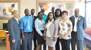 (Far left) Ronnie Einbeck, regional manager at SBN and  Bethuel Tjirera, head of distribution at the bank with staff of the Opuwo branch (Photograph contributed)