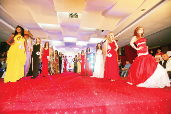 Miss Freedom of the World contestants on the ramp during the final show. Local beauty, Paulina Malulu appears in the bright yellow dress on the left.