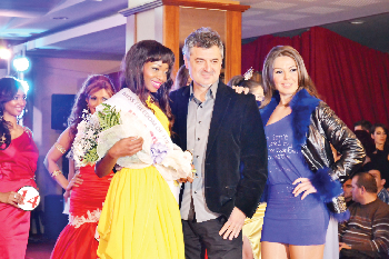 Namibian beauty, Paulina Malulu in the yellow dress, impressed judges at the recent Miss Freedom of the World pageant in Kosovo with her grace and natural beauty. During the event, she was named Miss Bikini. Here she is wearing the Miss Bikini sash over the gown she wore during the finals