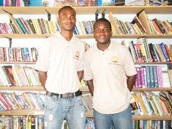 Marketing Director, Jordan Johannes and  CEO of Kasie Adventures Micheal Mulonga at the Young Achievers Library in Katutura. (Photograph by Yvonne Amukwaya)