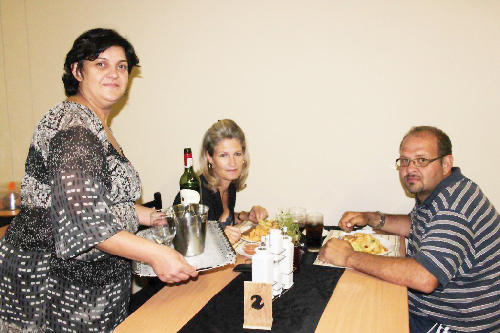 Liza Punzel serving Lenette van Wyk and Quintin Keys at  Bistro 'd café in Lüderitz (Photograph contributed)