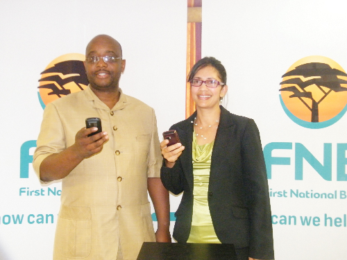 Deputy Mayor of city of Windhoek, Hon. Gerson Kamatuka with Desery van Wyk, FNB's manager of cellphone banking at the official launch of the FNB cell phone banking/City of Windhoek, pre-paid electricity purchase option on 21 February.