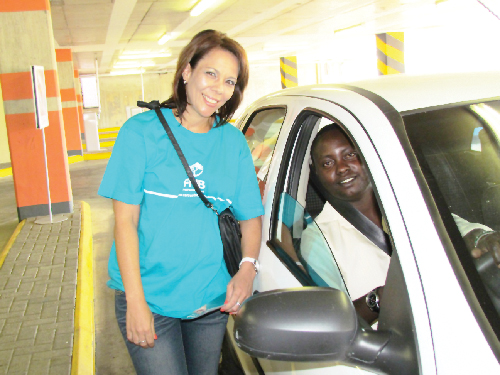 FNB employee, Lelwine Haji at the Wernhil Parking bay with a customer who received free Parking space at Wernhil Park Shopping center during the FNB UEPO Promotions.