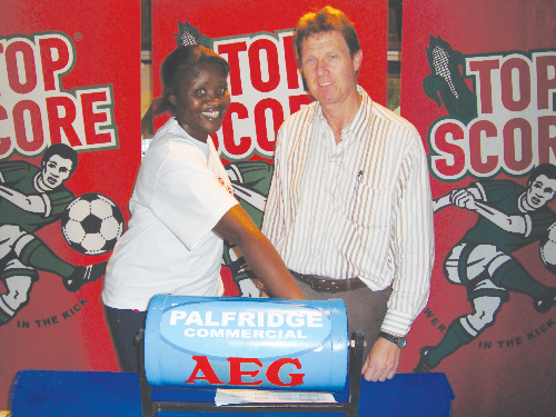 (Left to right): Margareth Gustavo, marketing manager at Namib Mills, with Mark Kutzner, Ramblers Football Club exco member at the Top Score 7-a-side Soccer League launch on Wednesday.
