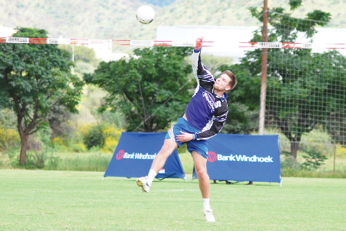 Patrick Schiep, a player from the German Fistball Bundesliga, hitting a strong shot for SFC.