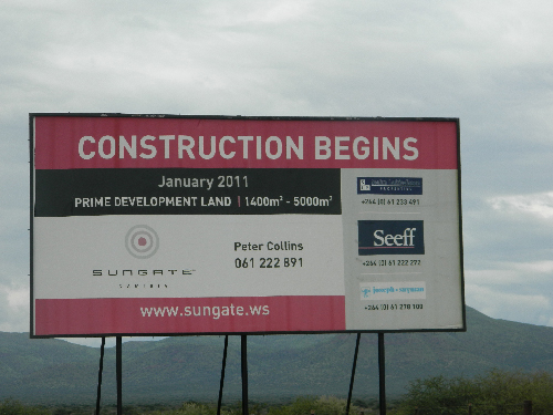 According to this billboard, construction at the site was supposed to start in January last year. (Photograph by Clemencia Jacobs)