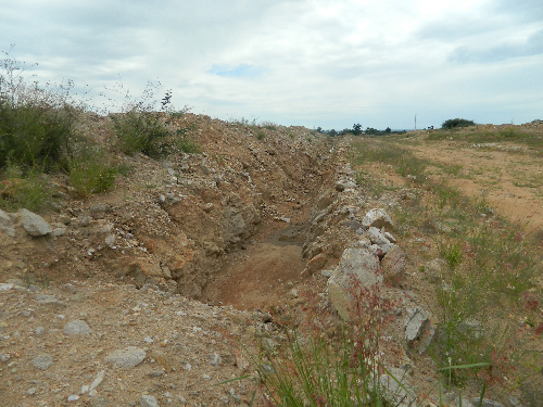 Trenches have been dug for what seems like a drainage system, however nothing much is happening at the site. (Photograph by Clemencia Jacobs)