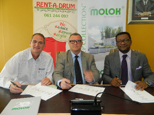 (From left to right): Gys Louw, owner of Rent-A-Drum, Jukka Blom, CEO of Molok and Tjama Tjivikua, rector of The Polytechnic of Namibia at the signing of the agreement between Molok and Rent-A-Drum. (Photograph by Lorato Khobetsi)
