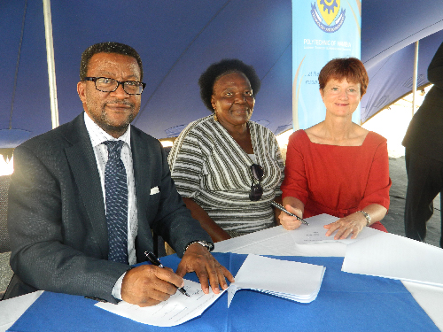 (Left to right) Tjama Tjivikua, rector of the Polytechnic of Namibia with Edith Mbanga, national coordinator of the Shack Dwellers Federation of Namibia and Ana Muller, national coordinator of the Namibia Housing Action Group at the signing of the formal agreement between the three institutions. (Photograph by Lorato Khobetsi)