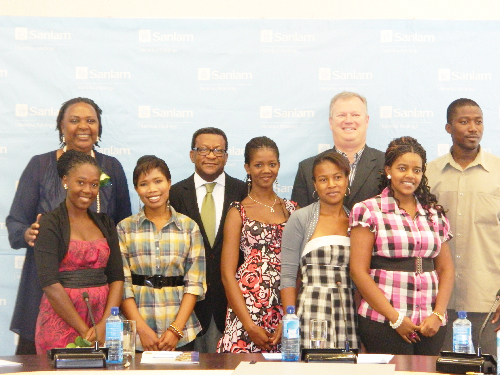 Left to right (back): Etambuya Mbuye, director of higher education at the National Council for Higher Education Secretariat, Tjama Tjivikua, Rector of the Polytechnic of Namibia, Tertius Stears, CEO of Sanlam, Swapo Party Youth League representative: Jonisiu Kambwale, together with the bursary recipients (front: left to right) Rebbeka Werner, Antonia Smith, Chaze Simanga, Petrina Keis and Desery Haimbodi at the Sanlam Namibia Bursary and computer equipment handover ceremony. (Photograph by Yvonne Amukwaya)