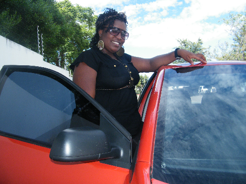 Faith Sankwasa, proud owner of the VW Polo - 2001 South African Car of the Year. (Photograph by Yvonne Amukwaya)