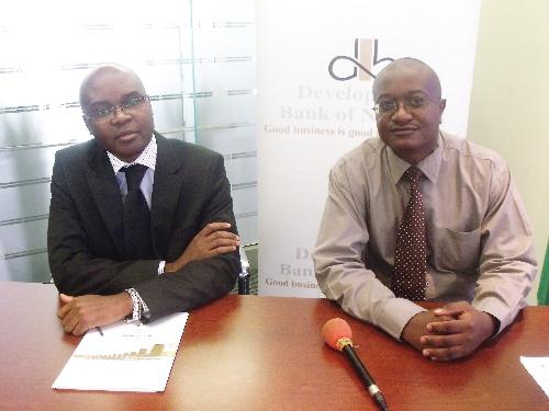 DBN's head of lending, Martin Inkumbi (left) and the bank's head of research, Michael Humavindu. (Photograph by Hilma Hashange)