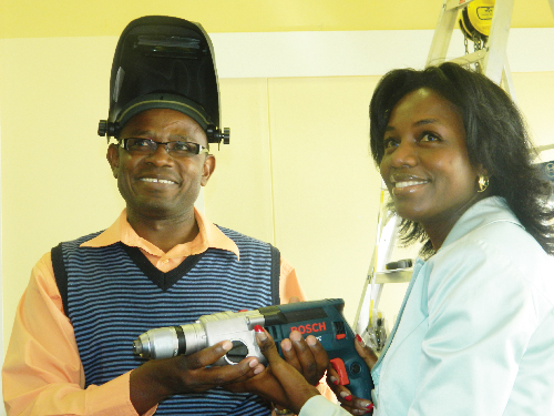 Ferdinand Ganaseb, the Namibia Training Authority's VTC transformation technical leader with Maria Nangolo-Rukoro, CEO of the Namibia Training Authority, at the tools and equipment handover ceremony, this week. (Photograph by Yvonne Amukwaya)