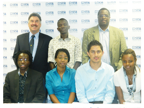 The five successful bursary recipients at the awards ceremony of the Roads Contractor Company with group general manager: revenue projects Dr. Pieter Oostuizen (left) and CEO Engelhard Haihambo (right) (Photograph by Yvonne Amukwaya)