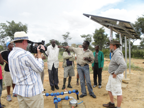Frank Bockmühl, geo-hydrologist, and Willem Shali, drilling operator on the project giving instructions to Okavango farmers on the use of the solar pumps and maintenance of all installations.