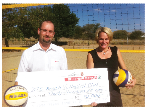Robert Voigts, MD of Maerua Superspar  with Antje Kesselmann, DTS Beach Volleyball chairperson.