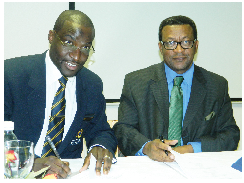 Martin Limbo, director of the National Disability Council and Tjama Tjivikua, Rector of the Polytechnic of Namibia, at the signing of a memorandum of understanding between the two parties this week. (Photograph by Yvonne Amukwaya)