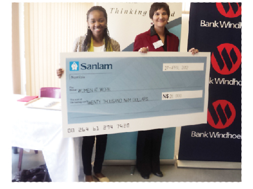 Theresia Tjihenuna, marketing and communications consultant at Sanlam, with Chantel Stroh, general manager of Women at Work, at the N$20 000 cheque handover ceremony.