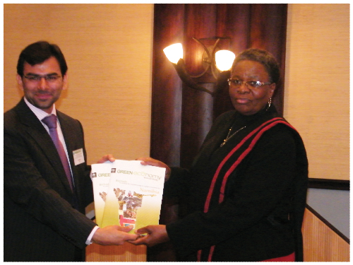 Asad Naqvi, coordinator of the UNEP-UNCTAD Capacity Building Task Force on Trade, Environment and Development and Netumbo Nandi-Ndaitwah, Minister of Environment and Tourism, at the launch of the Biotrade Report on Namibia at the International Biotrade Conference, this week. (Photograph by Clemencia Jacobs)
