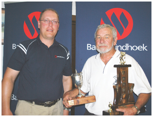 Bank Windhoek Senior Golf Tournament Champion, Barney Duddy (on the right), receiving his trophies from Thinus Prinsloo, executive director of Capricorn Investment Holdings.
