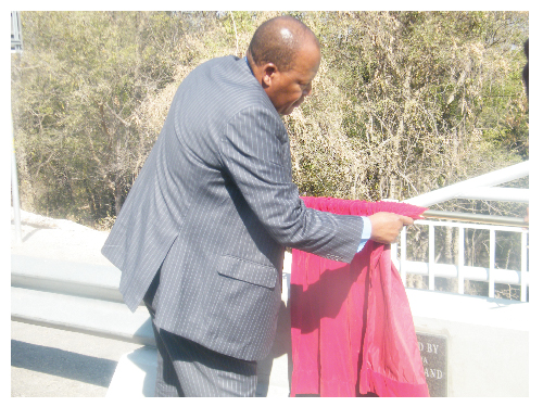 Minister of Works and Transport, Hon. Errki Nghimtina officially opening the expanded double-lane Divundu bridge. (Photograph by Hilma Hashange).