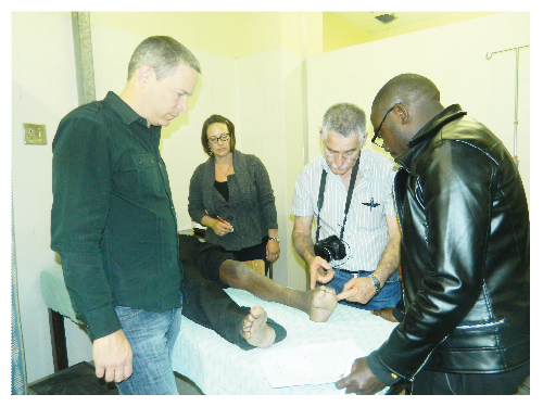 Dr. Bruce Lehnert, Jenny Lehnert, Dr. Meir Nyska and Dr. Tufikila Nakale screening an elderly patient who suffers from club foot deformity at Katutura State Hospital on Wednesday 13 June 2012. (Photograph by Hilma Hashange).