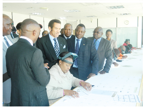 President Khama flanked by Mines and Energy Minister, Errki Nghimtina and Deputy Minister Isak Katali during a site tour to the NDTC offices in Windhoek. (Photograph by Hilma Hashange).