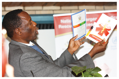 Minister of Health and Social Services, Dr Richard Kamwi showing the policy documents to the public.(Photograph by Melba Chipepo)
