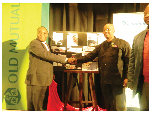 Chief Executive Officer of Operations at Old Mutual, Sakaria Nghikembua and Deputy Mayor of the City of Windhoek, Gerson Kamatuka shaking hands at the handover of the Old Mutual Jazz Encounters label to the City of Windhoek.