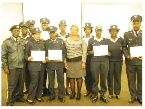 Commissioner Festus Shilongo with the members of the Namibian Police Force stationed in Khomas who graduated in Information Technology recently.