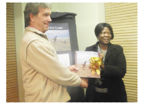 Mrs Rosina //Hoabes (photo R) and Mr Nehemia Salomon (Photo S), chairperson of the Management Committee of the Swakopmund Town Council, were delighted to receive a complimentary copies of the book from Mr Rod Braby. A total of almost 2000 copies will be on sale at retail outlets in Namibia. Proceeds from the sales will contribute towards a reprint. Book sales make a direct contribution to conservation of the coast.
