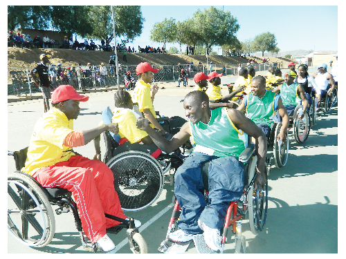 "The Northern-based Oshana wheelchair team(green shirts) defeated the Khomas squad(yellow shirts) with a score of 28-8 during a 40 minute game earlier this month. The match was held during the two-day National Disability Day commemoration by the National Disability Council of Namibia under the slogan ""Nothing about us, without us."" (Photograph Yvonne Amukwaya)"