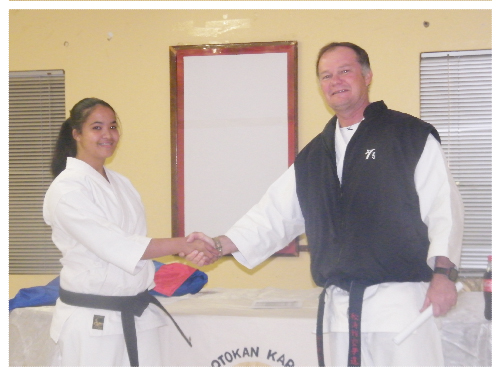Head of the recently-launched Khomasdal dojo, Morchen Kruger being congratulated by Shotokan Karate Style head, Sensei Willem Burger at the launch of the Khomasdal-based club. (Photograph Yvonne Amukwaya)