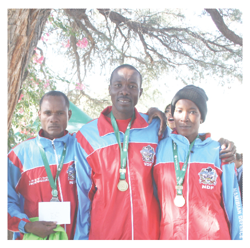 (Left to right): Pineas Embashu, who came second in the 5km male 20 to 39 category; Frans Hosea who came first in the 5km male 20 to 39 category and Rachel Akukothela who was also first in the female 5km 20 to 29 category in Keetmanshoop.