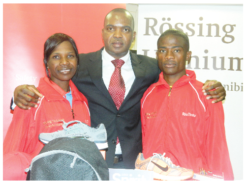 Jerome Mutumba flanked by Helaria Johannes(left) and Paulus Iyambo at the Rössing Marathon Development Bonus Sponsorship. (Photograph by Yvonne Amukwaya)