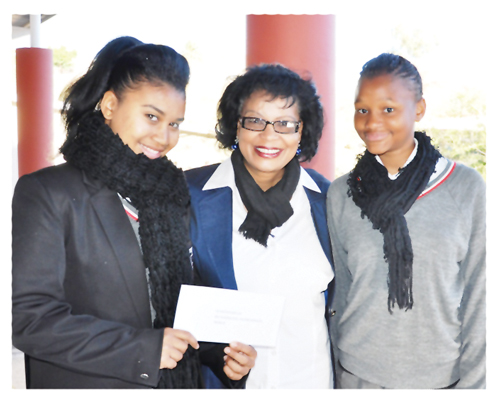 St George's teacher, Ms Mavis Mannetti (middle) with business plan winners, Caneesha Ngavetene (left) and Laetitia Katiti.