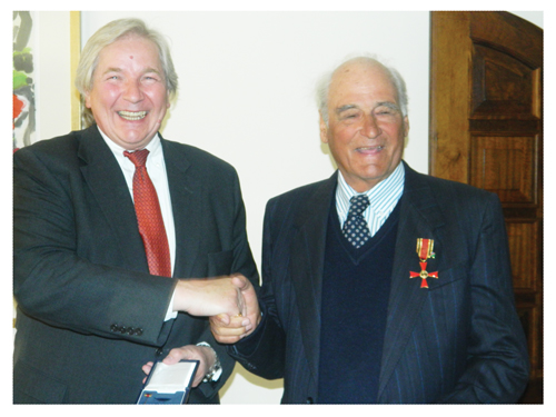Reiner Stommel receiving the Cross of the Order of Merit from His Excellency Egon Kochanke, the Ambassador of the Federal Republic of Germany in Namibia (Photograph by Hilma Hashange)