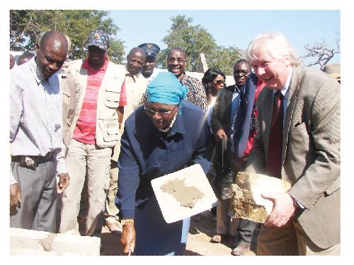 Minister of Environment and Tourism, Hon Netumbo Nandi-Ndaitwah and German Ambassador Egon Kochanke lay the first stone at the Bwabwata park station. (Photograph by Angi Storbeck of the BMM Parks Project ).