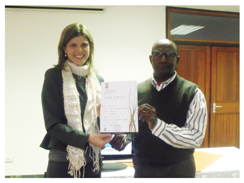 Lizette Foot, general manager of Team Namibia hands the Team Namibia certificate to Matheus Amadhila, Deputy Chairman of the Namibia Fish Consumption Promotion Trust board of directors at the Polytechnic Hotel School this week. (Photograph by Lorato Khobetsi)