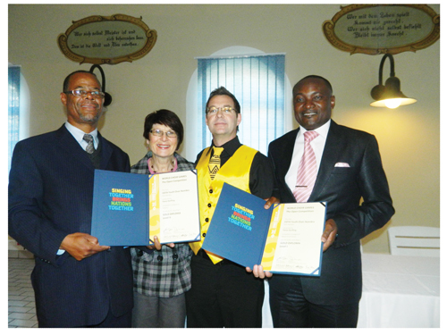 From left to right, Steve Katjiuanjo, Permanent Secretary of the Ministry of Youth, National Service. Sports and Culture, Erina Junius, Rector of the College of the Arts, choir conductor Fanie Dorfling, and Pohamba Shifeta, Deputy Minister of Youth, National Service, Sport and Culture, holding the two prestigious awards won by the Conservatoire Youth choir. (Photographed by Melba Chipepo.)