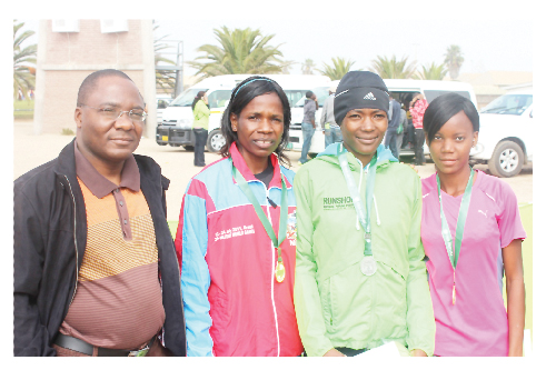 (From let to right): Sakaria Nghikembua CEO: Operations at Old Mutual with winner, Johannes Hilalia, Beata Naigambo and Lavinia Haitope who came in second and third respectively in the 20 to 39 female category.
