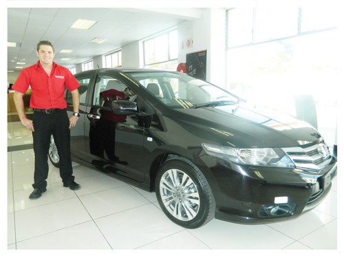 Sales execitive, Jaun Nel with the magnificent Honda Ballade.