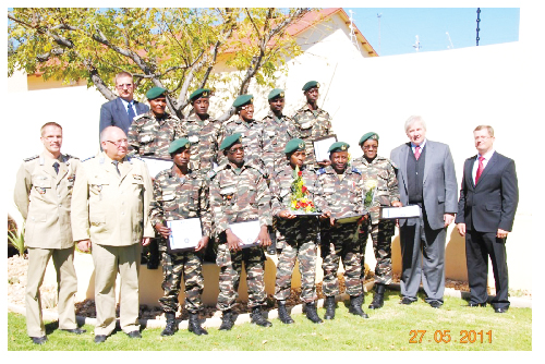 Sergeant Major F. Martens and Lt Col A. Moeller (front left), German Ambassador, Egon Kochanke and ATA International director, Trevor Justus, (front right) with the first batch of trainee soldiers to specialise  in medical emergencies. In the back stand Mr P. Schoeman.
