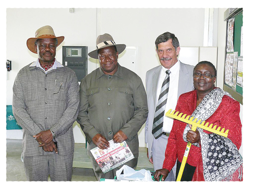 Minister Alpheus !Naruseb and his wife, Mrs. Trooi !Naruses and Minister John Mutorwa, with Ryno van der Merwe, Chairman of the Board of Directors of Agra, after shopping at Agra Oshivelo.