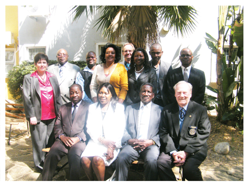 Newly elected members of the 4th Library and Information Council (From left to right) Judy Grobler, Mocks Shivute, Micheal Skini, Veno Kauarika, Werner Hillebrecht, Sarah Negumbo, David Paulus and Charles Mlambo with (Seated: left to right) Education Minister, Abraham Iyambo, incoming Chairperson, Ellen Namhila, outgoing Chairperson, Elia Kaiyamo and Kenneth Howes.(Photograph by Lorato Khobetsi)