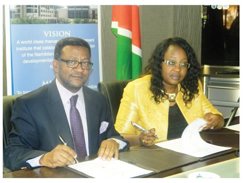 Acting executive director of NIPAM, Elsie Mghikembua and Polytechnic Rector, Tjama Tjivikua at the signing of the MoU between the two institutions earlier this week. (Photograph by Lorato Khobetsi)